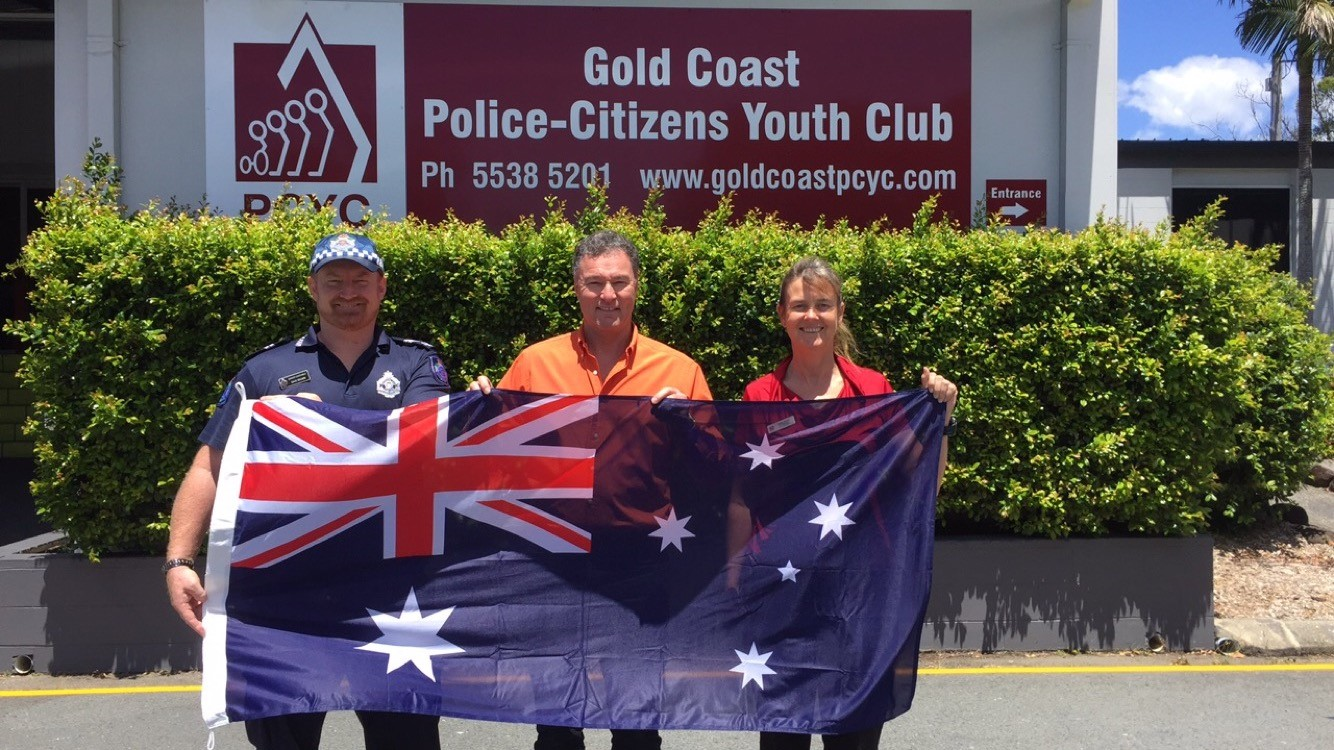 Presenting an Australian Flag to the Gold Coast PCYC